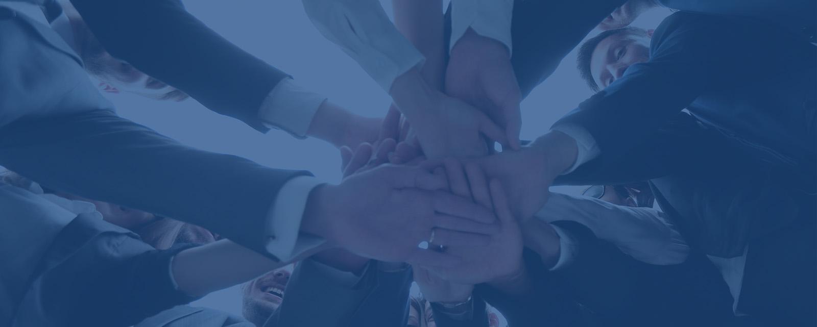 Team putting hands together