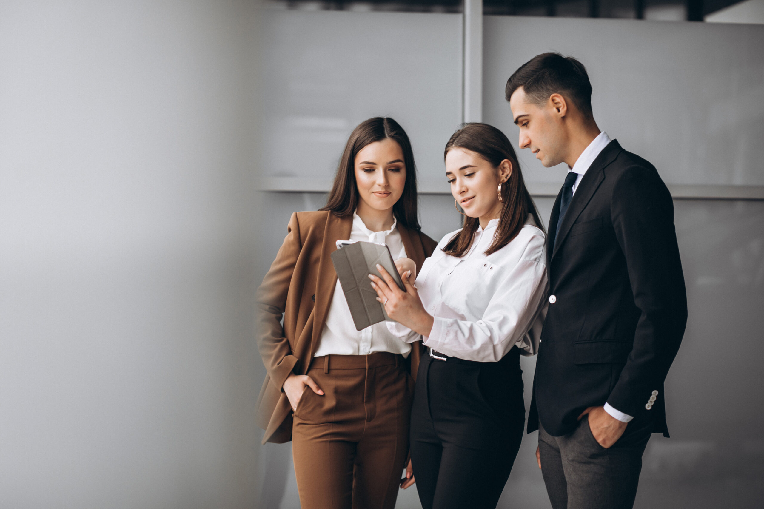 People in formal work attire working together