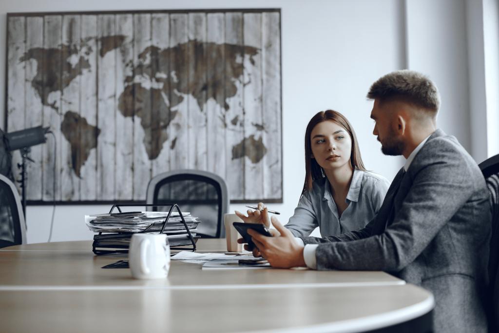 Office meeting between two people in formal wear