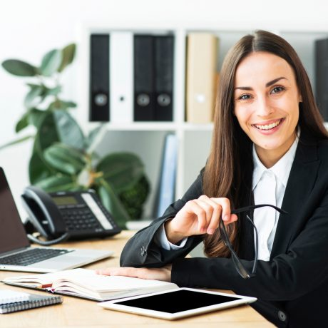Woman in smart work attire smiling at camera